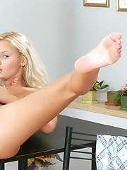 Sexy blonde Jenny is showing off her pink pussy and dildoing hard